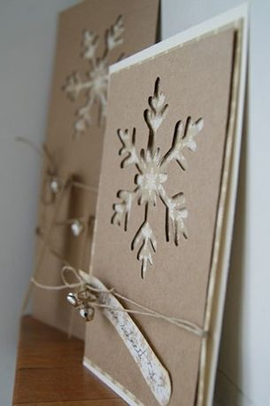 """❄Snowflake Card cut out of Kraft paper, layered with cream paper and tied with twine/jute cord. beautiful, but I would try different cut outs with colors, such as poinsettia cut out over red paper, Christmas tree over green paper (adding glittery """"snow"""" on the branches). Also, a bell cut-out over vintage Christmas music. You could do this with other holidays, ❤too--so many possibilities!"""