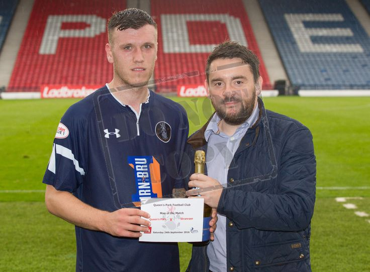 Queen's Park's Adam Cummins picks up his Man of the Match after the Ladbrokes League One game between Queen's Park and Stranraer