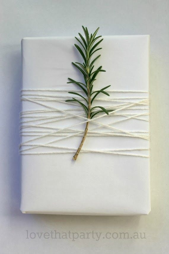 A sprig of rosemary not only looks super romantic and fresh, but it also smells delicious. Wrap some white wool around the stem to keep it snuggly in place for all the times people will inevitably lift up the package to get a whiff.  See more at Love That Party »   - HouseBeautiful.com