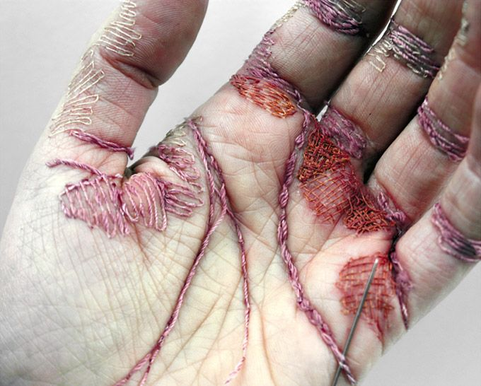 Using her own skin as a canvas, British artist Eliza Bennett has stitched into the palm of her hand using thread to create the appearance of an incredibly work worn hand.