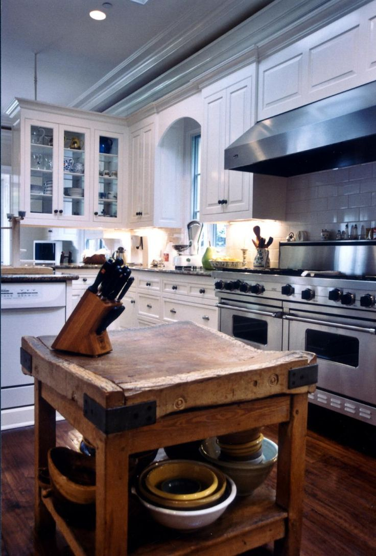 Large White Kitchen with Vintage Butcher Block. By designer Susan Jay. Via ASID.