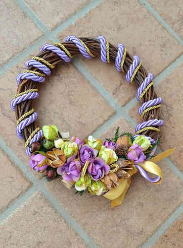 MEDIUM SIZED WREATH – Lavender - PatriziaB.com  Bring good tidings of joy with this handcrafted wreath. Woven from wicker, it is embellished with silk cordon spirals