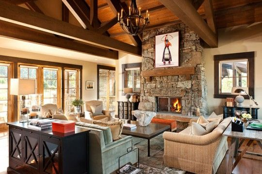 The beautiful stone fireplace, featuring a flat willow moss rock veneer harvested in Montana, is the focal point in the great room. The artwork atop the mantel is part of the home's extensive art collection.