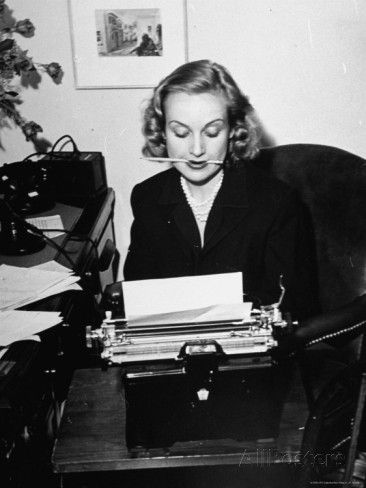 Actress Carole Lombard Typing While Holding Pencil Firmly in Her Mouth by Rex Hardy Jr.