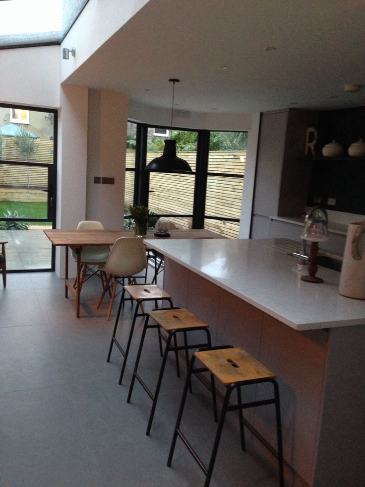 Industrial kitchen, crittal doors and concrete tiles
