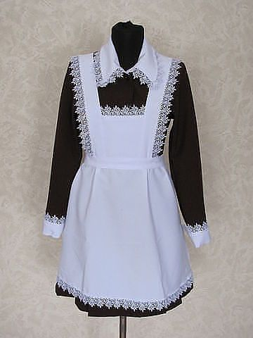 Soviet school uniform for girls. White apron for special days, black apron for everyday