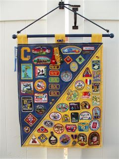 Scout Banner's - how to display patches as they move up in scouting http://homeschoolstamperof3.blogspot.com/2010/07/scout-banners.html#
