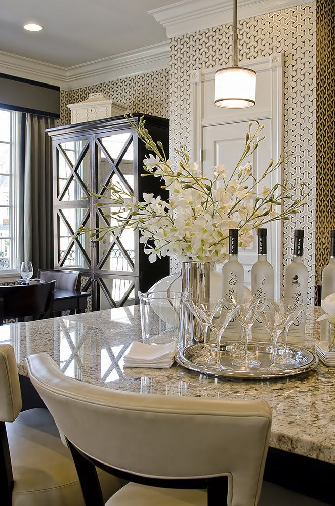 elegant living  -  beautiful wall paper, crown moulding trim and furniture and window treatments and countertop