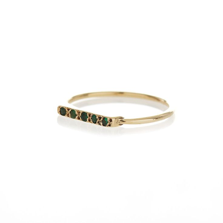 9ct yellow gold ring with a 5 centered emeralds.