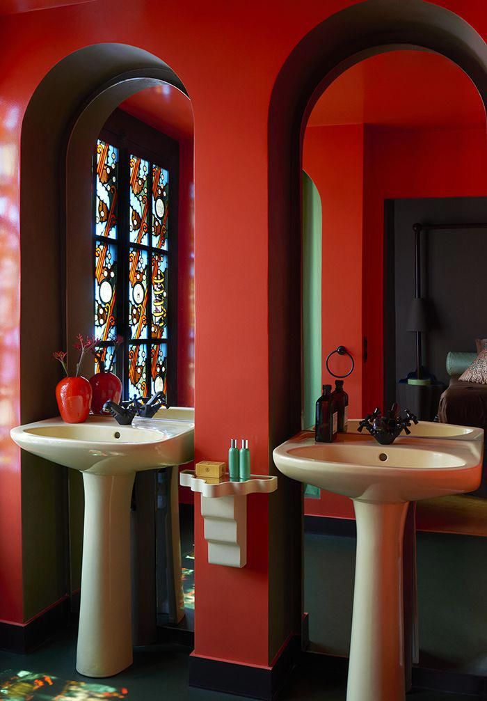 On the bathroom side, the stained glass windows, which act as