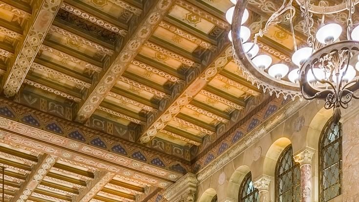 The rich history of the Courtyard-Marriot Hotel is told in the soaring, colorful ceilings and expansive marble columns sourced from Great Britain, France and countries around the Mediterranean Sea.