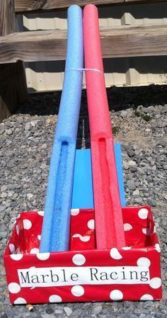 Carnival Party ~ Marble Race ~ made with cut pool noodles, box wrapped in wrapping paper, two marbles - Crafting By Holiday