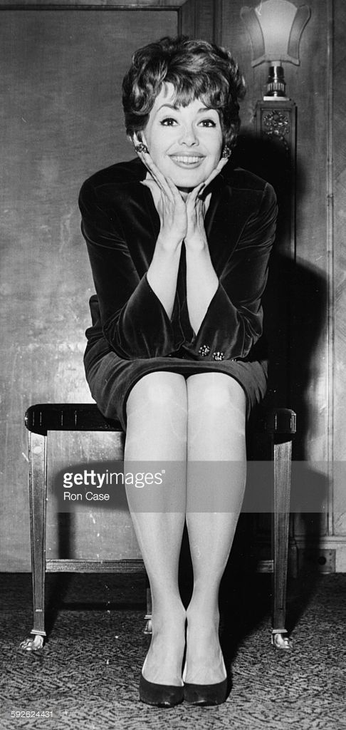 Actress Barbara Rush sitting on a bench with her hands under her chin, at a press reception on her way to Winter Olympic Games in Innsbruck, at the Dorchester Hotel in London, January 30th 1964.