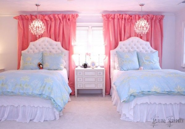 I love how the curtains frame, but don't cover the window, and provide a fabulous backdrop for the bed. Of course, the chandeliers are nice, too. As are the tufted headboards...