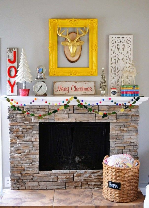 source: The Alison Show 4. Christmas Village You don't need some giant, fancy display to make a statement with your Christmas decorating. This minimalist design is festive and fun! It's like a tiny Christmas village in the form of a wreath. And those little pine trees standing along the mantel? How cute! You'll see moreContinue Reading...