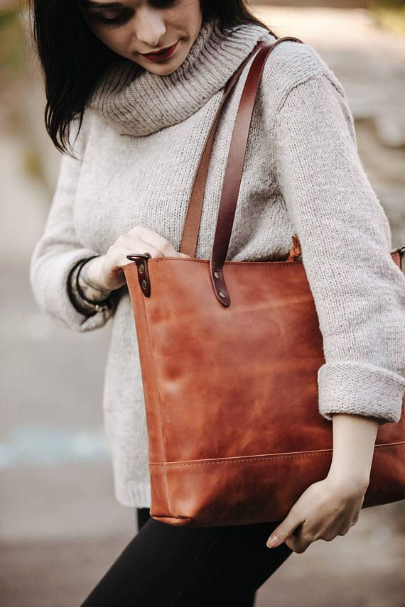 The classic tote by Kruk Garage. Smooth, genuine leather in a brushed, tonal effect, detailed stitching and an extra-spacious interior make this tote bag a winner. It comes with a leather pocket inside. DETAILS: - Cognac brown genuine Full grain saddle leather - vegetable tanned