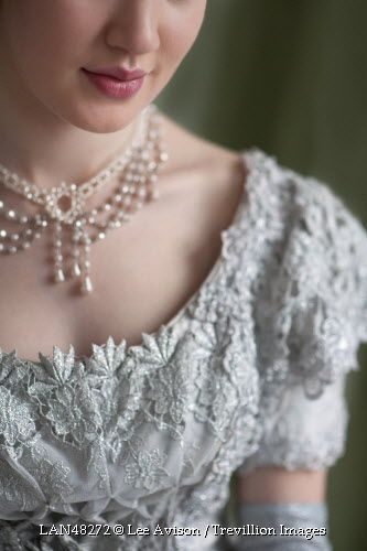 Trevillion Images - historical-woman-smiling with beautiful white lace bodice on a ball gown and strings of pearls