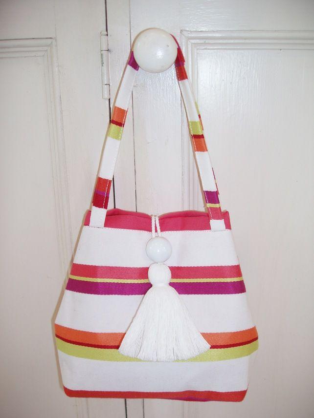 Smal stripey handbag with tassel fastening £20.00