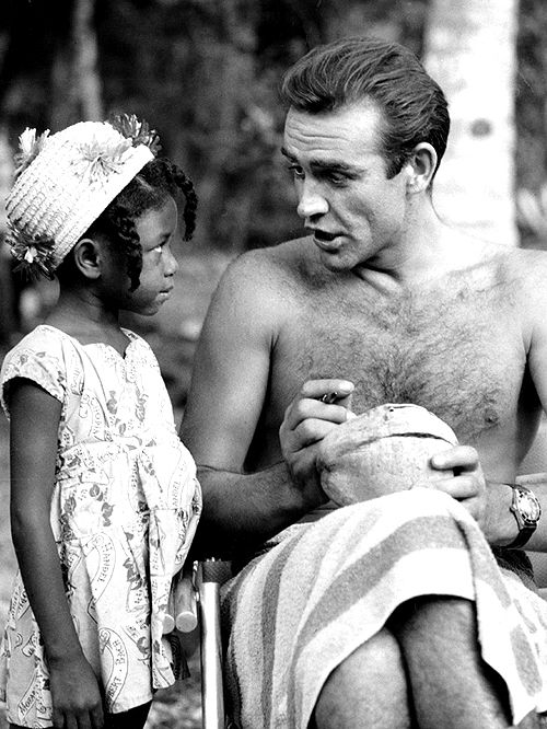 Sean Connery signing a coconut for a little Jamaican fan on the set of Dr. No