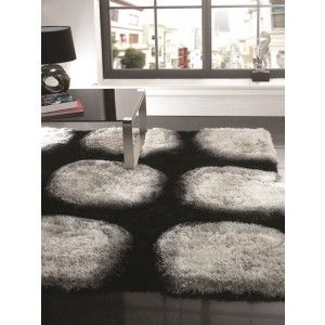 Black with Grey Dot Shaggy Rug. Made from 100% polyester.