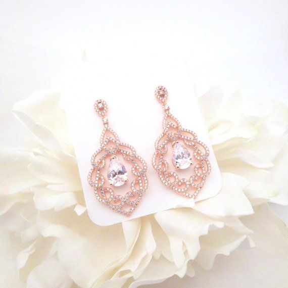 These beautiful earrings are available in rose gold finish or rhodium silver finish. They are studded with tons of pave style Swarovski Pure