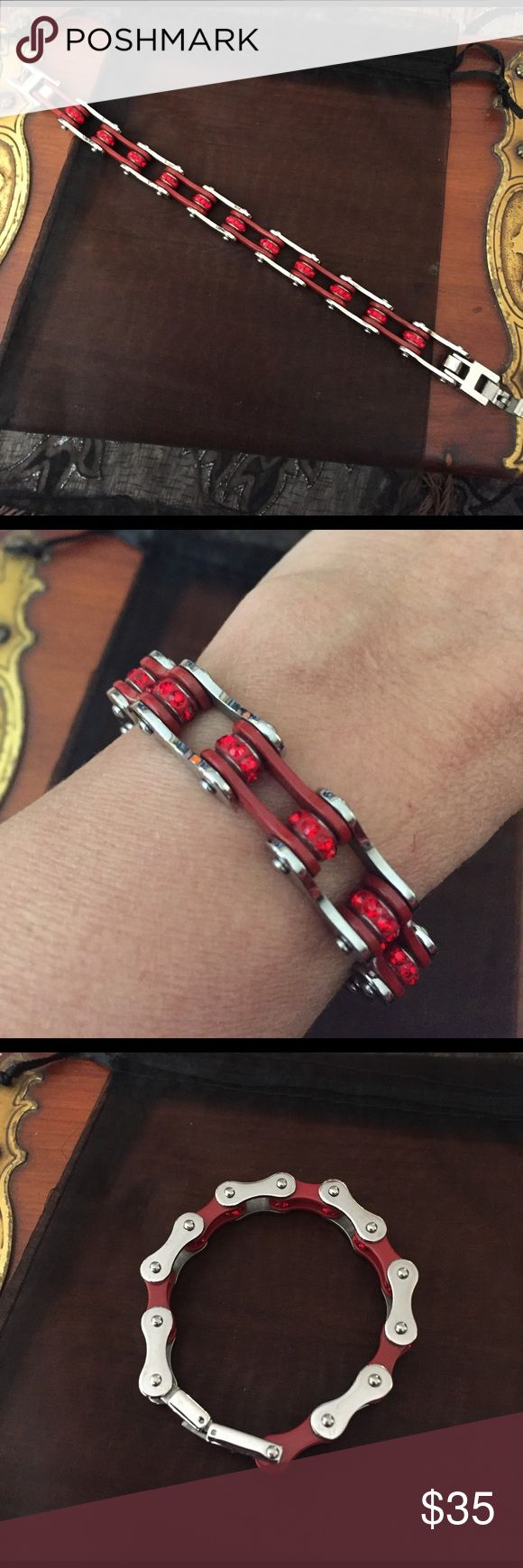 Harley Davidson Chain Link Bracelet Silver toned with red enamel with red crystals. This was purchased at a Harley store in Wisconsin but I've seen them for sale in other places. This bracelet has not been worn. Length is 7.5 inches. Harley-Davidson Jewelry Bracelets