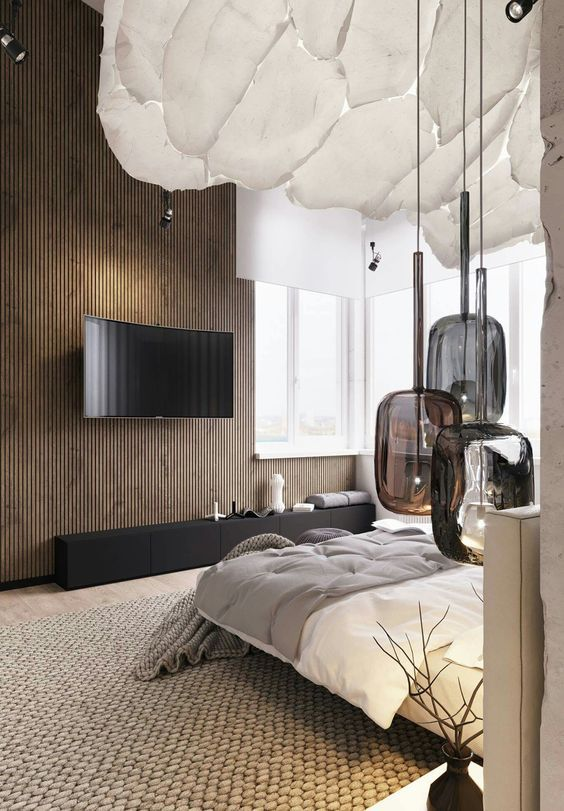 So much texture in this bedroom, yet it still looks super modern. We love the organic lines and patterns of the ceiling, accessories and lighting. Warm, bright and light yet moody and cozy.