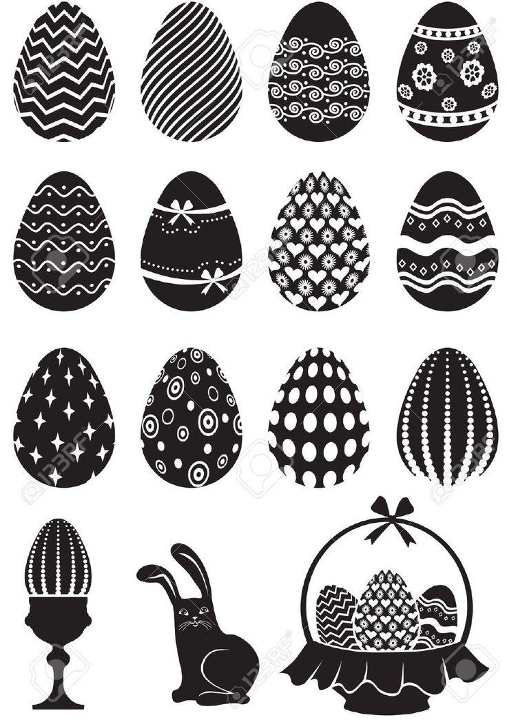 Conjunto de huevos de pascua decorados en blanco y negro con adornos.