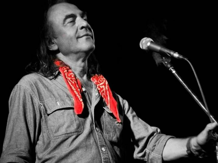 """Nikos Papazoglou (1948-2011) was born in Thessalonki.In 1976 he built his own studio that became very influential in the underground rock music for many years to come.Out of music he considered """"most important is the interpretation making people radiate and glow """" In his concerts he used to perform with his band, a baglama and the famous red bandana around his neck."""