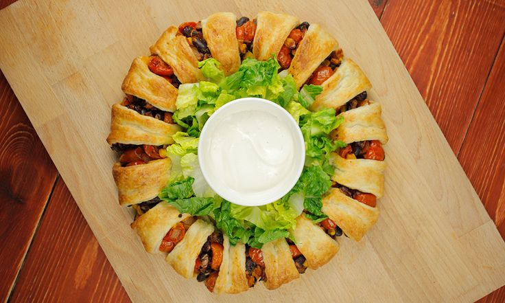 We have to say, we're so chuffed with how this recipe has turned out. Who knew making an awesome taco ring could be so easy? We decided to use a sheet of puff pastry, which is cut into 16 triangles, but you can use dough already shaped into triangles, if this is easy to findRead more