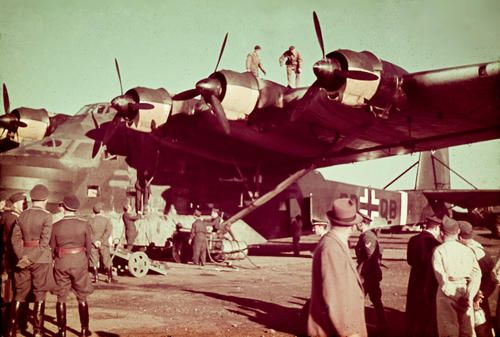 "Luftwaffe's Messerschmitt Me 323 ""Gigant"" (Giant) landed on one of Rome's area airports, probably Ciampino, able to accommodate a large aircraft of this type (motorized version of the huge transport glider Me 321 with six radial engines)."