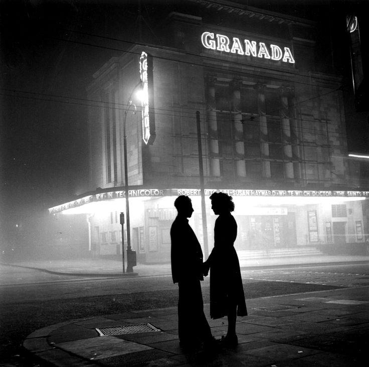 Bert Hardy: A young woman talks to a boyfriend after her evening's work as a cinema usherette, circa 1954