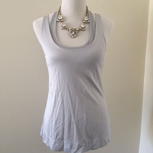 Armani Exchange Top Silver top. Built in bra. New with tags. Bundle three or more items together for 20% off Armani Exchange Tops Tank Tops