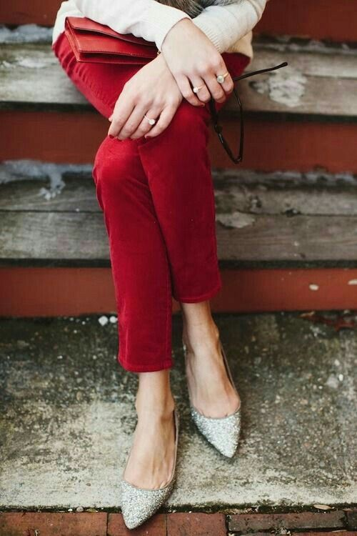 Red pants, white sweater, metallic shoes. (This could also do well for an office holiday party.)