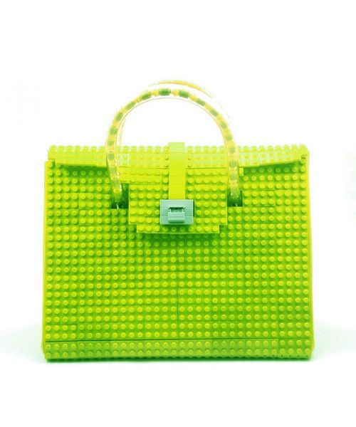 This lime AGABAG tote is a chic choice for everyday use. It is handcrafted with LEGO bricks. Its interior is generously proportioned to fit all of your daily essentials, including an iPad and work documents.