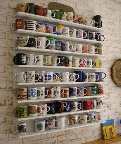 Beautiful, organized, collected cups and ceramics...it is functional artwork!
