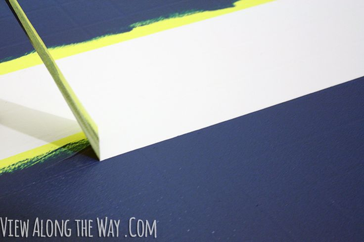 How to paint vinyl/laminate floors! It's easy and inexpensive! Click through for the full tutorial