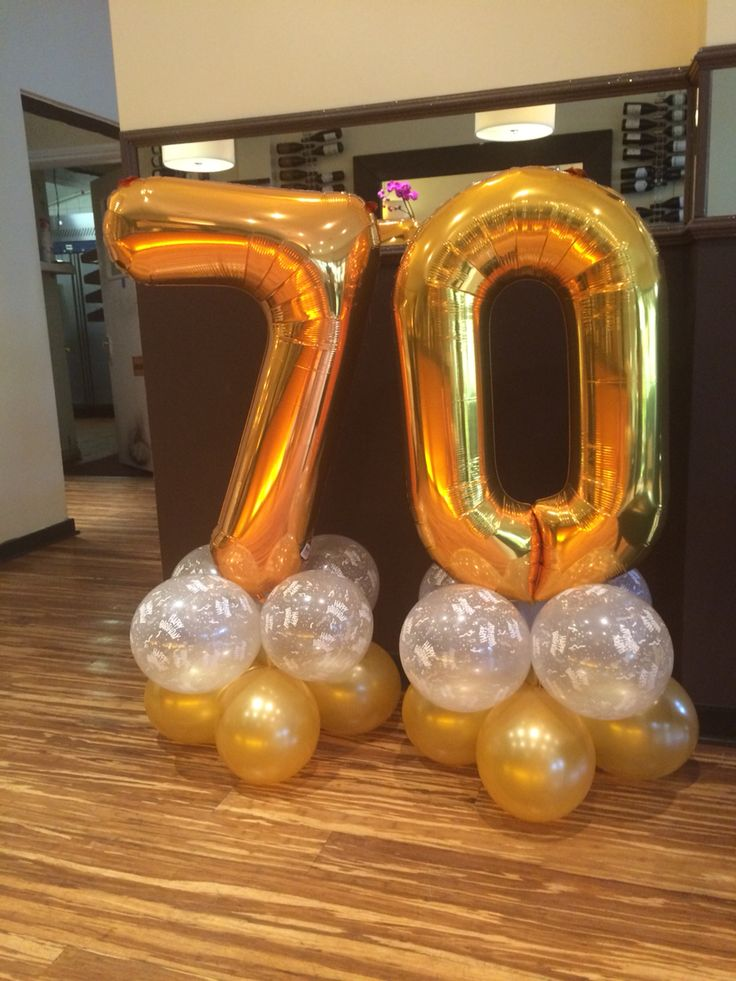 70th Birthday balloons in gold and clear 'happy birthday'