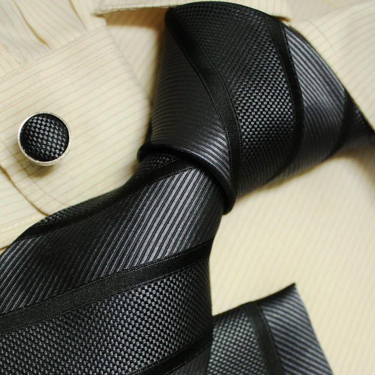 Classic black silk tie, cuff links and handkerchief set. Love the subtle texturing of this tie and would look awesome with a black suit and crisp white shirt.