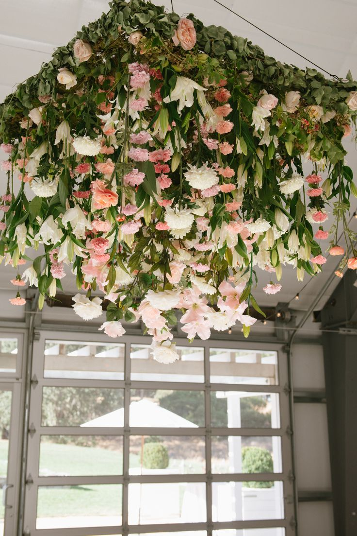 #floral Chandelier Photography: Sylvie Gil Photography    Sylviegilphotography.com Florals : Twigss