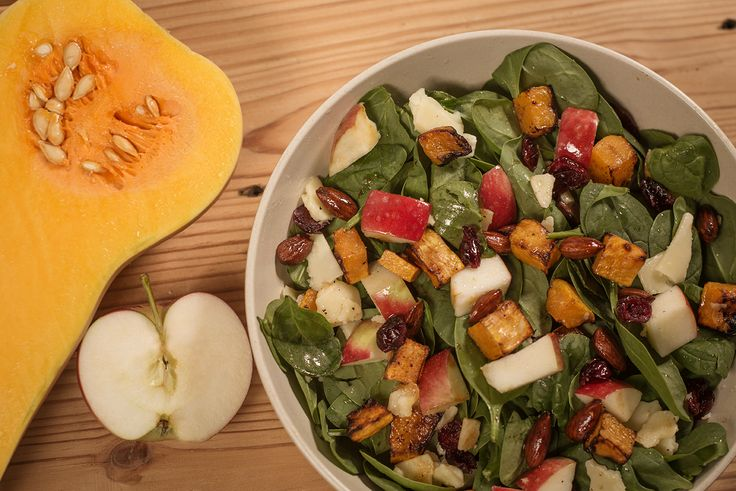 Sweet squash, crunchy almonds, tangy white cheddar, juicy pomegranate seeds: our roasted butternut squash salad is a fall all-star. Don't miss it!