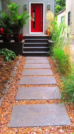 Experts in landscape and floral design are a great source for inspiration when seaching for ideas to improve your home's curb appeal. Like this example from earth and sole, you too can use simple material such as paver stones, landscape peebles and perennial grasses to give the pathway to yor home a very zen-like feel.