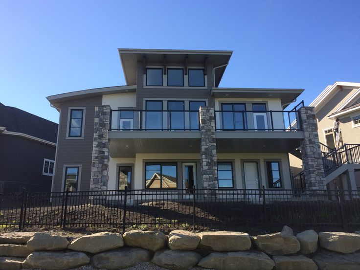 Contemporary windows and roof lines enhance the back of this house #contemporary windows #contemporary roof lines #coopersairdrie