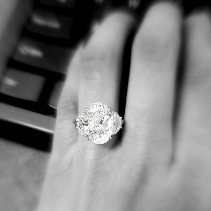 Classic Three Stone Engagement Ring With Oval Center And