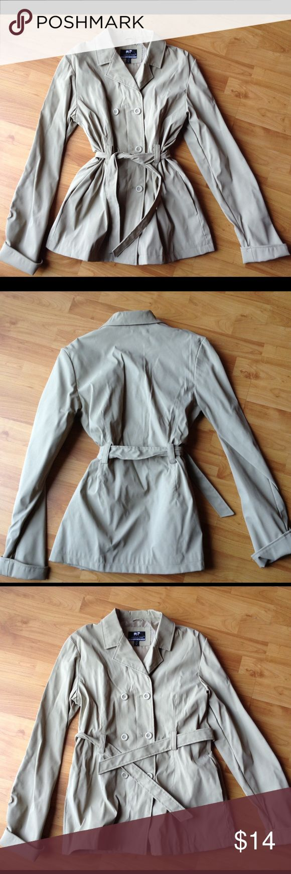 Ladies Raincoat Like New; Ladies Raincoat in a polyvinyl material Jackets & Coats