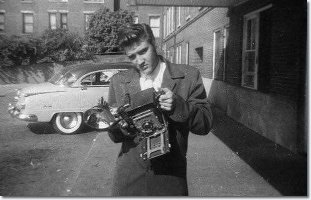 a photographer was there , and a frien from Humes High asked Elvis to hold the photographers camera . He did !