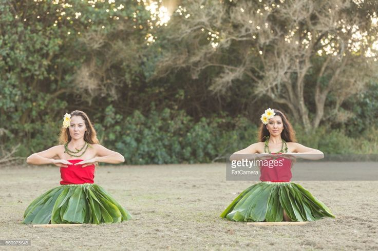 Beautiful young local woman practices hula on a beautiful day outside