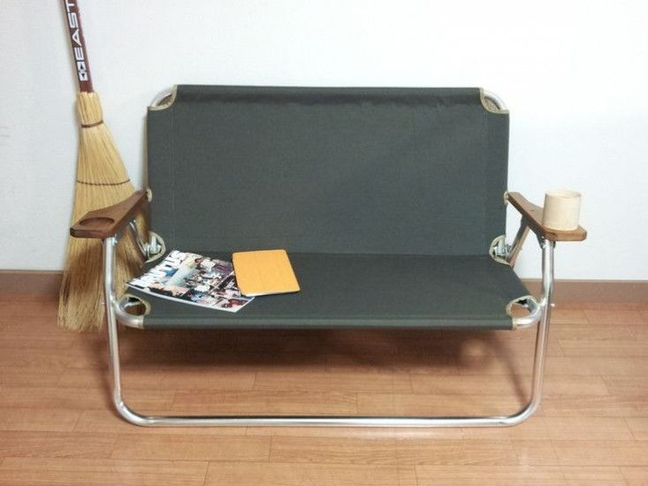 Peregrine Camp Furniture Settee | Remodelista Ecdysis Bench has cedar armrests that hold cups; ¥28,000 ($273).