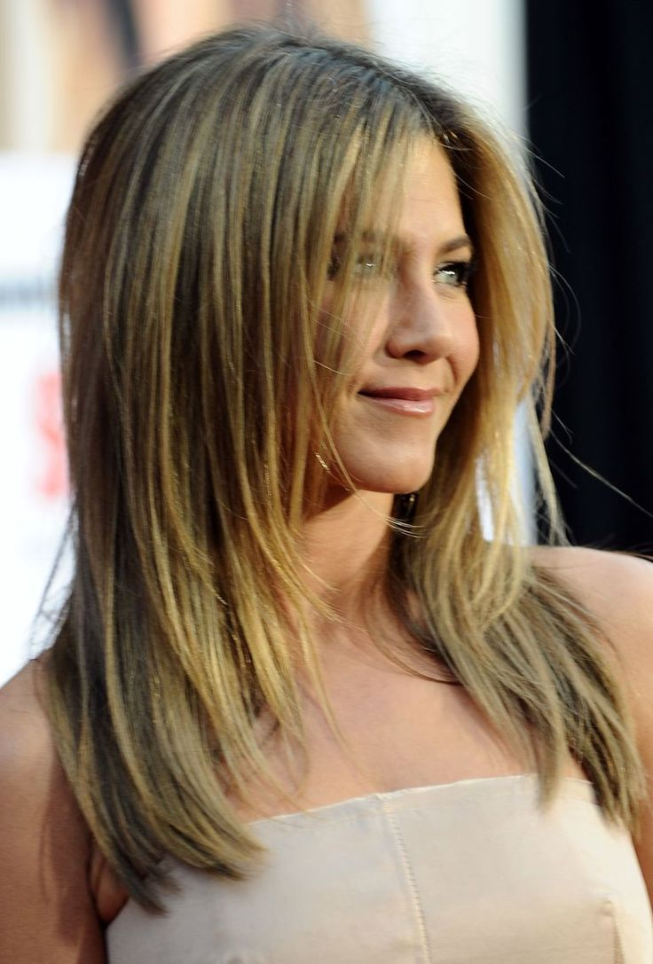 See pictures of Jennifer Aniston's hair over the years from The Rachel to her lob (long bob) to her current blonde hairstyle.