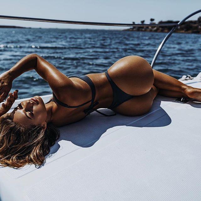 Beautiful Sexy Woman In Swimwear Relaxing On A Yacht Stock Image